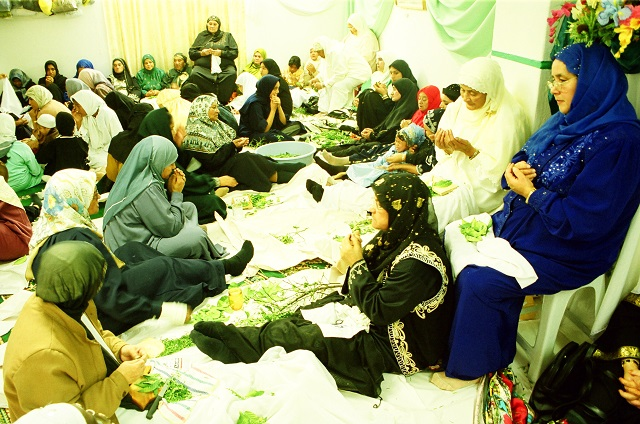 Muslim women in Cape Town prepare 'rampies,' scented lemon tree leaves wrapped in a piece of fabric, to be handed out as gifts during celebrations of the Birthday of the Prophet. Photo by Yazeed Kamaldien