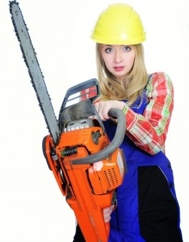 Woman holding a chainsaw