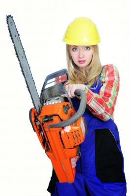 Second Job - Woman holding a chainsaw