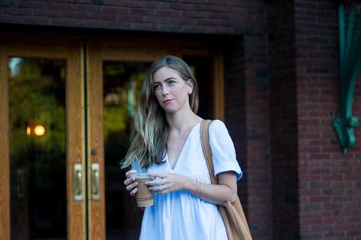 blue dress in front of door