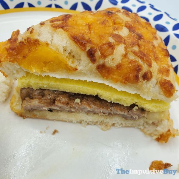 Cinnabon Breakfast Creations CheddarRoll Sausage  Egg Sandwich Closeup 2