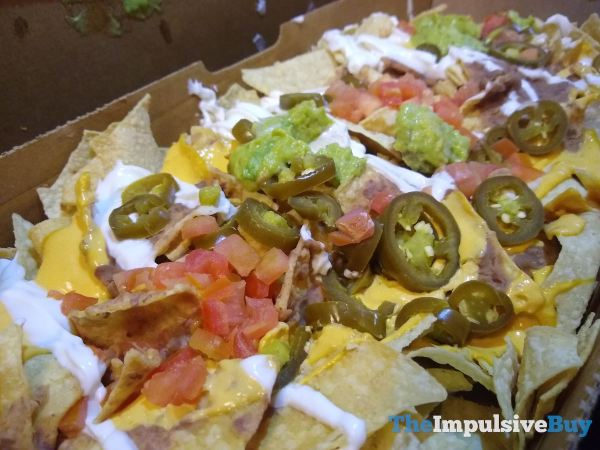 Taco Bell Veggie Nachos Party Pack Guac and Jalapeno Closeup