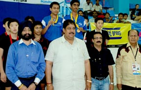 Table Tennis Federation of India president Ajay Singh Chautala with the winners in the ITTF Junior Circuit Table Tennis Tournament in Pune on Monday.