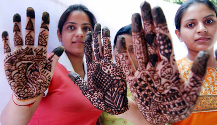 Young girls show their hands decorated with 'Henna' (Mehndi) on the eve of Karva Chauth at Amritsar on Thursday. PHOTO-PRABHJOT GILL AMRITSAR