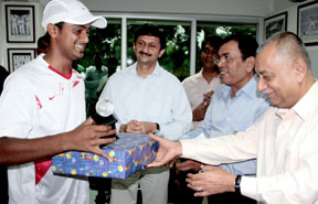 Adviser to the Chandigarh Administrator ,Pradip Mehra presenting man of the match award to Chetan William of State Bank of Mysore, Banglore, in the 15th All India J.P. Atray Memorial Cricket Tournament in Chandigarh on Wednesday