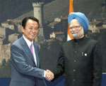 The Prime Minister, Dr. Manmohan Singh meeting the Prime Minister of Japan, Mr. Taro Aso, on the sideline of G-8 and G-5 Summit, in L'Aquila, Italy
