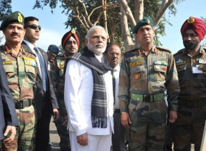 The Prime Minister, Shri Narendra Modi being given a presentation on counter-terrorist and combing operation by the Defence Forces, at Pathankot Airbase on January 09, 2016. The Chief of Army Staff, General Dalbir Singh is also seen.