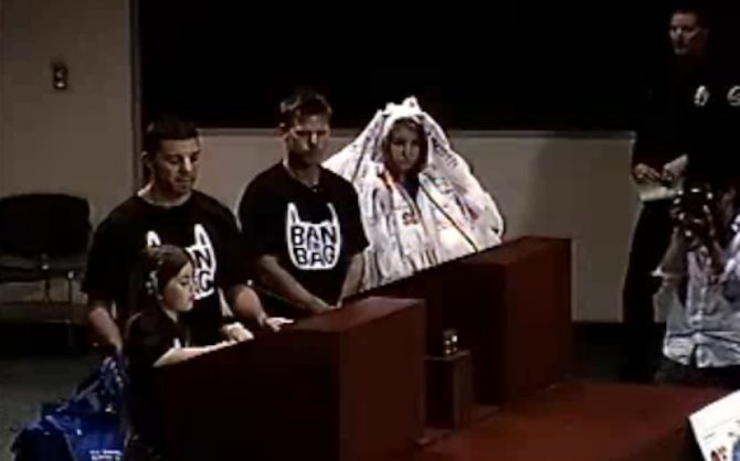 Zoe Florence (left), Aimee Borgmeyer (right), and two representatives from Surfrider's local chapter speak at an HB city council meeting in August, 2011. Photo: HBTV