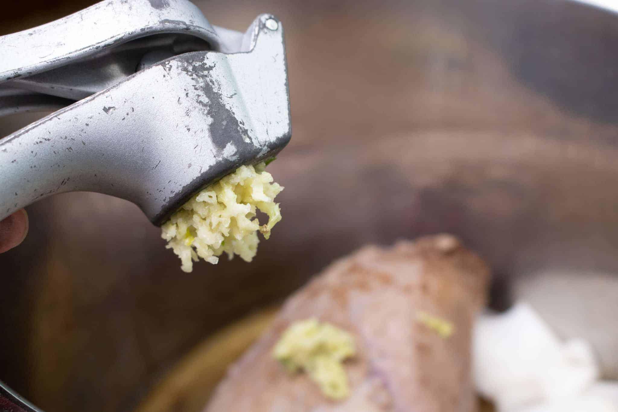 Yum, garlic makes your easy instant pot pot roast even tastier!