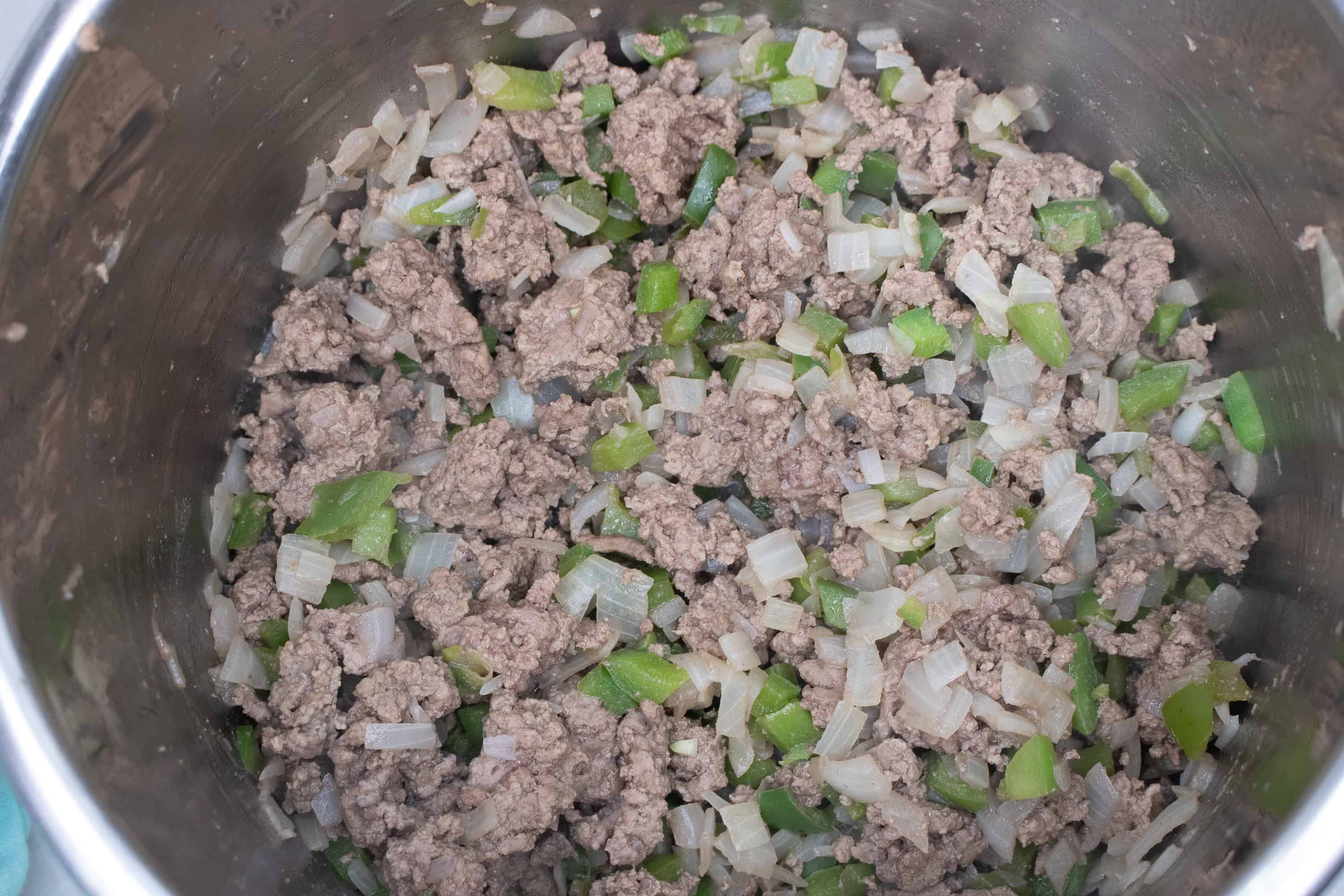 brown ground beef with onions and veggies