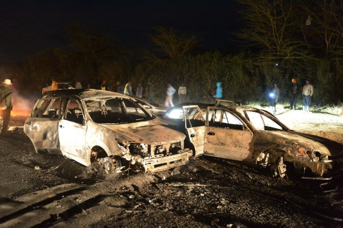 Vehicles damaged in an oil tanker explosion are seen in Karai, Naivasha, on December 11, 2016.  At least 25 people have been killed and several others injured when a fuel tanker lost control and rammed into several vehicles before bursting into flames in Naivasha. / AFP PHOTO / Simon MAINA