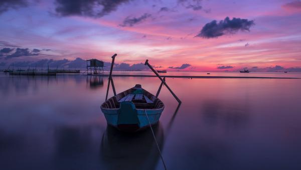 sunrise boat on lake