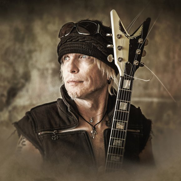 Michael Schenker states Contraband group disbanded after fight between Tracii Guns and Richard Black