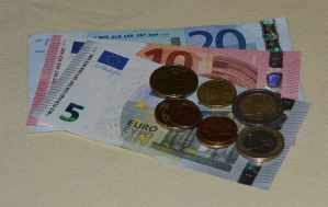 Some Euro Bank Notes and Coins - The Irish Place
