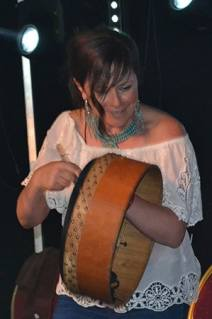 Cathy Jordan of Dervish in action on Bodhrán. - The Irish Place