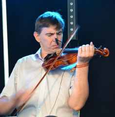 Michael Queally of the Co. Clare band Moher on Fiddle at The Doolin Folk Festival 2016. - The Irish Place