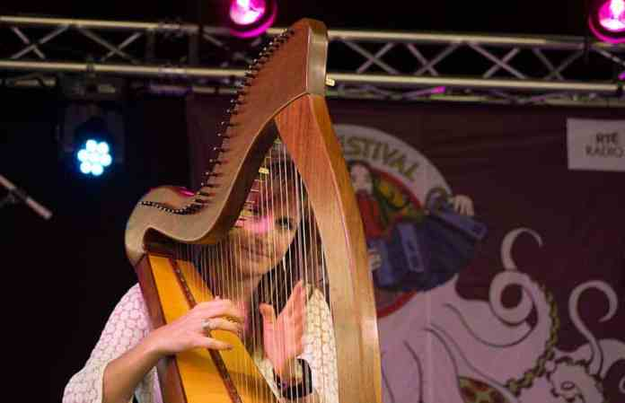 Elaine Hogan playing the Celtic Harp on stage at the 2017 Doolin Folk Festival