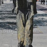 A child too weak to walk being carried (Famine Memorial Statues) - The Irish Place