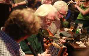 Musicians playing in an Irish Traditional Music session at Cooley's House, Ennistymon, Co. Clare - The Irish Place
