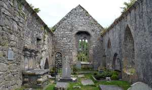 Inside Kilnaboy Church showing the blocked doorway and offset window - The Irish Place