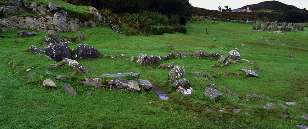 The joined stone huts at Drombeg Stone Circle - The Irish Place