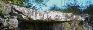 Ogham Stone used as lintel in northern window near the east gable - The Irish Place