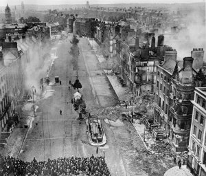 Crowds watch as the last anti-Treaty forces are cleared from O'Connell Street in July 1922.