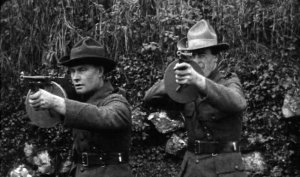 Two IRA Volunteers demonstrate the Thompson submachine gun, in Dublin 1921.
