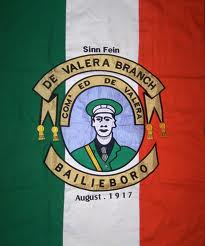 A flag from 1917 featuring Eamon de Valera, the last surviving commandant of 1916.