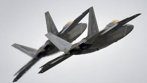 US F-22s Fire Warning Flares At Russian Su-25 Jets