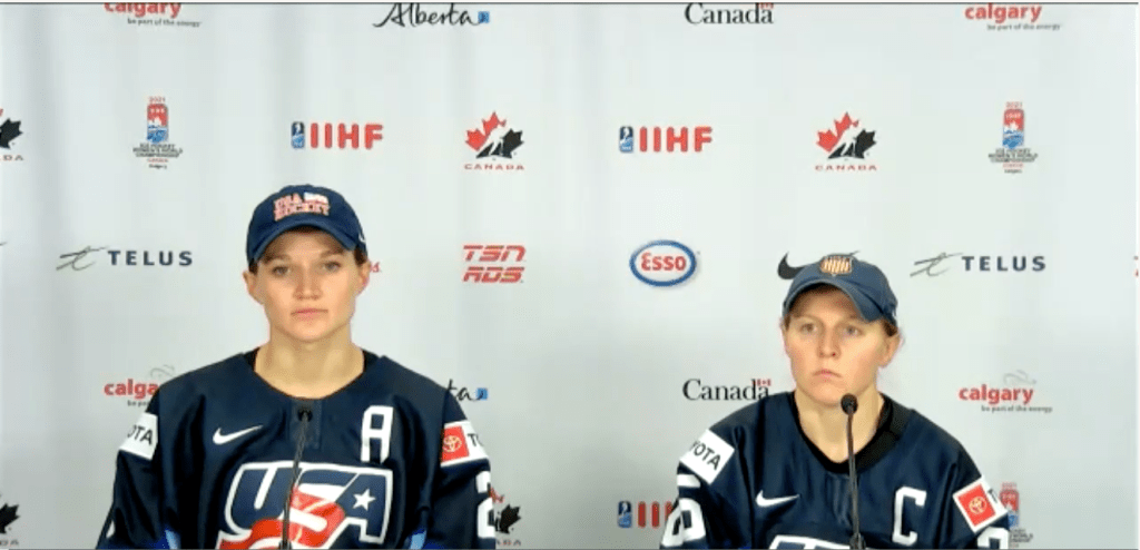 USA CAPTAINS LEE STECKLEIN (LEFT) AND KENDALL COYNE SCHOFIELD TALK TO MEDIA AFTER A 5-1 LOSS TO CANADA. AUGUST 26, 2021, CALGARY, ALBERTA