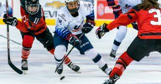 Briana Decker puck handles through Canadian defense. Photo by Matthew Raney.