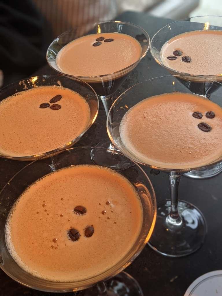 A photo of several espresso martini's on a table