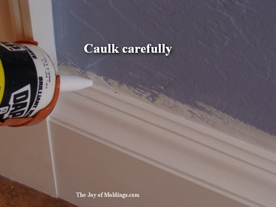 caulk baseboard trimwork