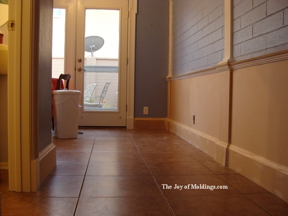 Large diy baseboard on wainscoting