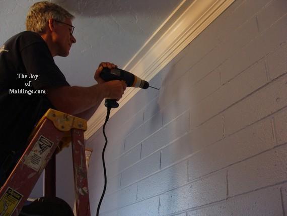 install moldings on brick wall