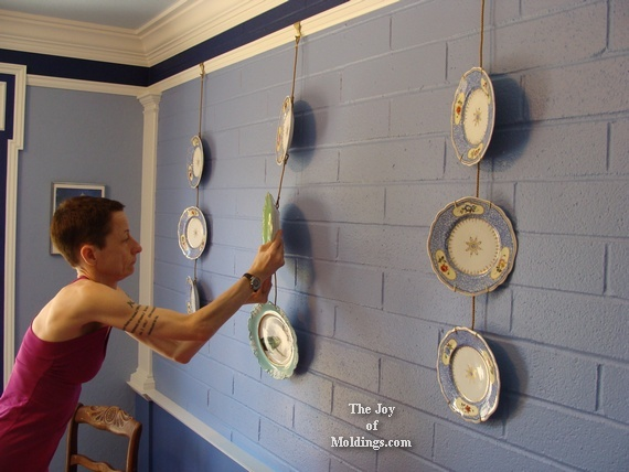 french plates hanging from picture rail molding