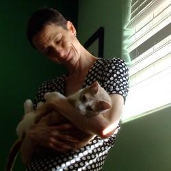 beautiful wife holding cat