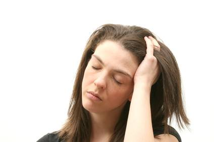 woman with a headache over white background