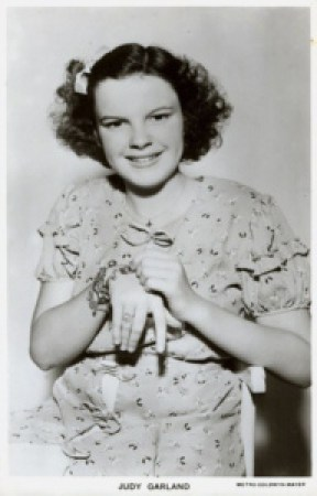 "Judy Garland with her ""Clark Gable"" charm bracelet"