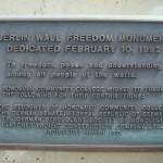 A bronze plaque on the Freedom Memorial tells the story of the wall at HCC.