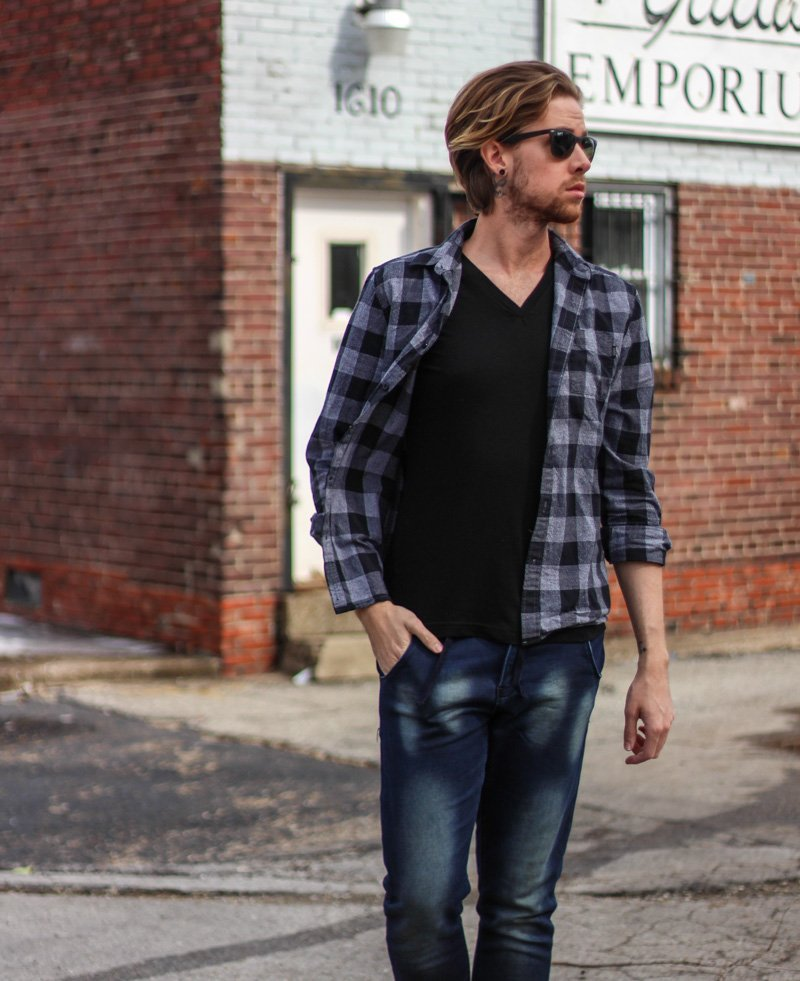 The Kentucky Gent in Paul Rizk Jeans, WeSc Checkered Plaid Shirt, BDG Black V Neck T Shirt, Ray-Ban Wayfarers, and Steve Madden Troopah Boots