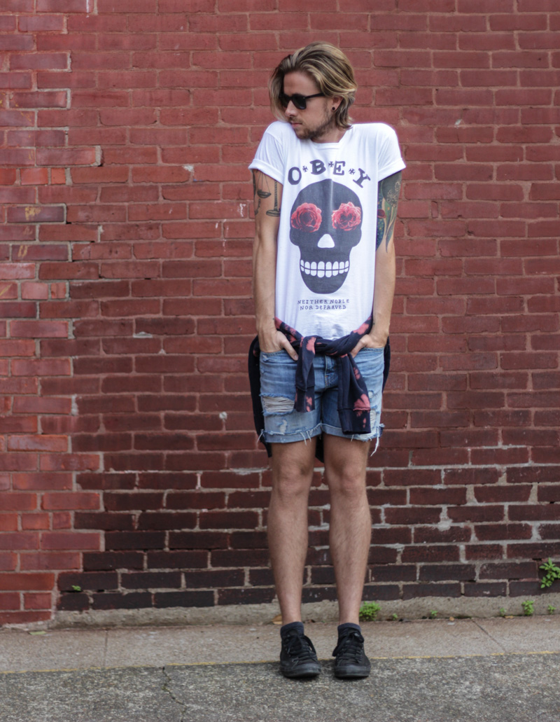 The Kentucky Gent in Obey Sugar Skull T-Shirt, Ray-Ban Wayfarers, Levi's Cut Off Shorts, Devil's Harvest Tie Hoodie From Urban Outfitters, and Converse Chucks.