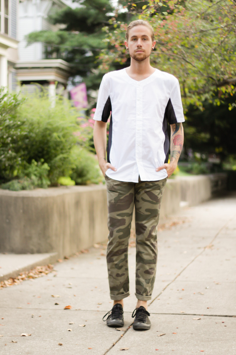 The Kentucky Gent, a men's fashion and lifestyle blogger, in Narrows Mesh Panel Shirt, Dockers Camo Pants, and Converse Chuck Taylors.