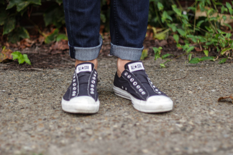 The Kentucky Gent, a men's  fashion and life style blogger, in BDG Baseball T-Shirt, Ambig Jeans, and Converse Chuck Taylors.