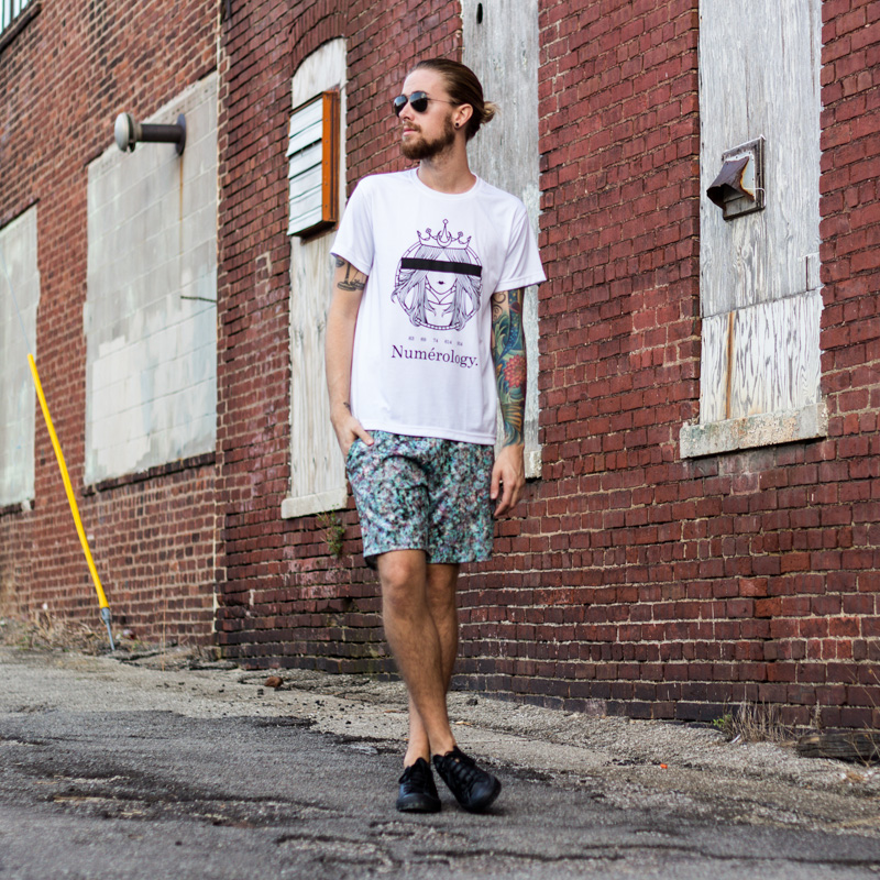 The Kentucky Gent, a men's fashion and life style blogger, in Numerology Tee, Topman Neoprene Shorts, Converse Chuck Taylors, and Ray-Ban Aviator Sunglasses.