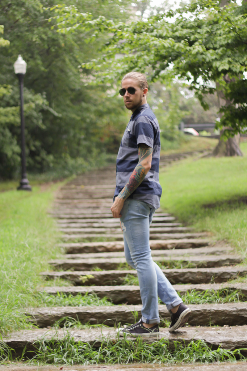 The Kentucky Gent, a men's fashion and life style blogger, in Ambig Striped Short Sleeve Button Up Shirt, H&M Light Wash Denim Jeans, Converse Chuck Taylors, and Ray-Ban Aviator Sunglasses from East Dane.