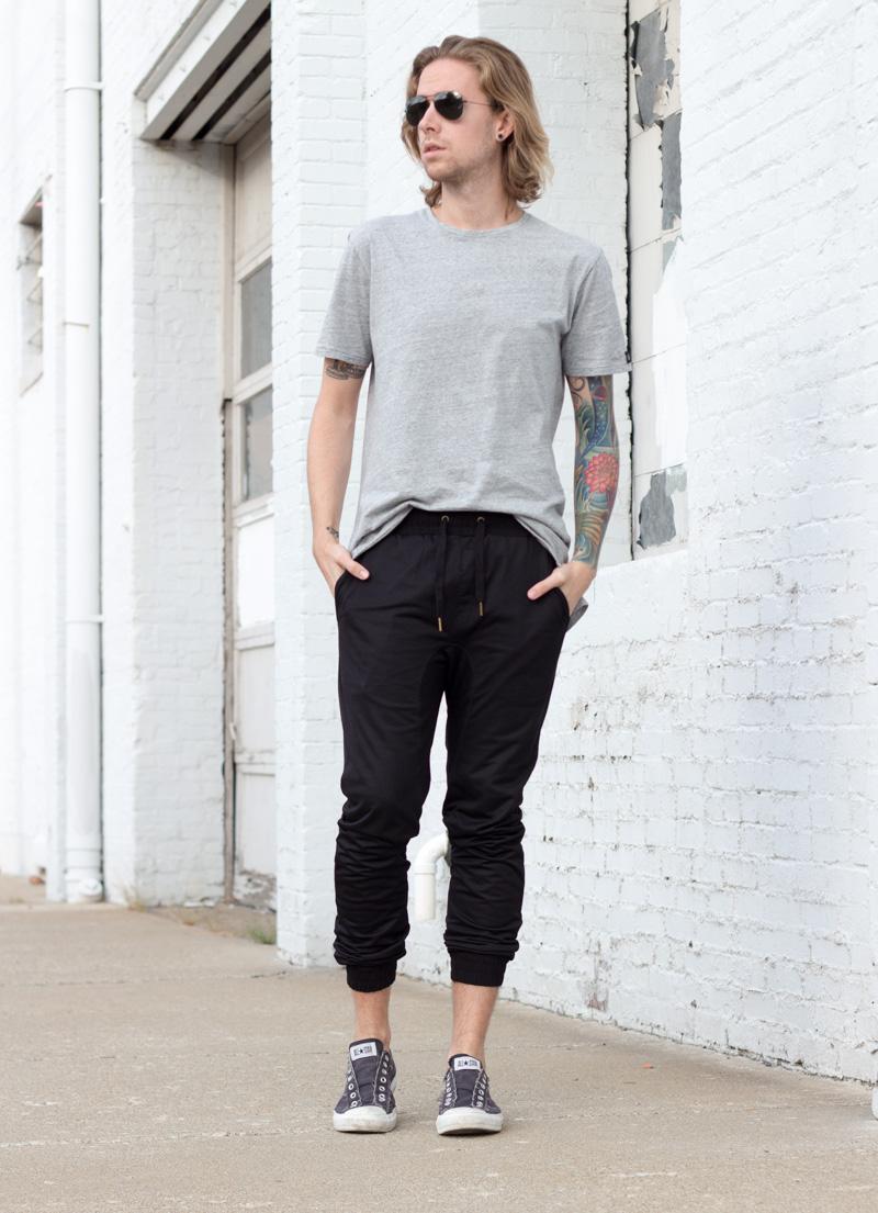 The Kentucky Gent, a men's fashion and lifestyle blogger, in Zanerobe T-Shirt, UNIF Plaid Shirt, Zanerobe Mesh Joggers, Converse Chuck Taylors, and Ray-Ban Aviator Sunglasses.