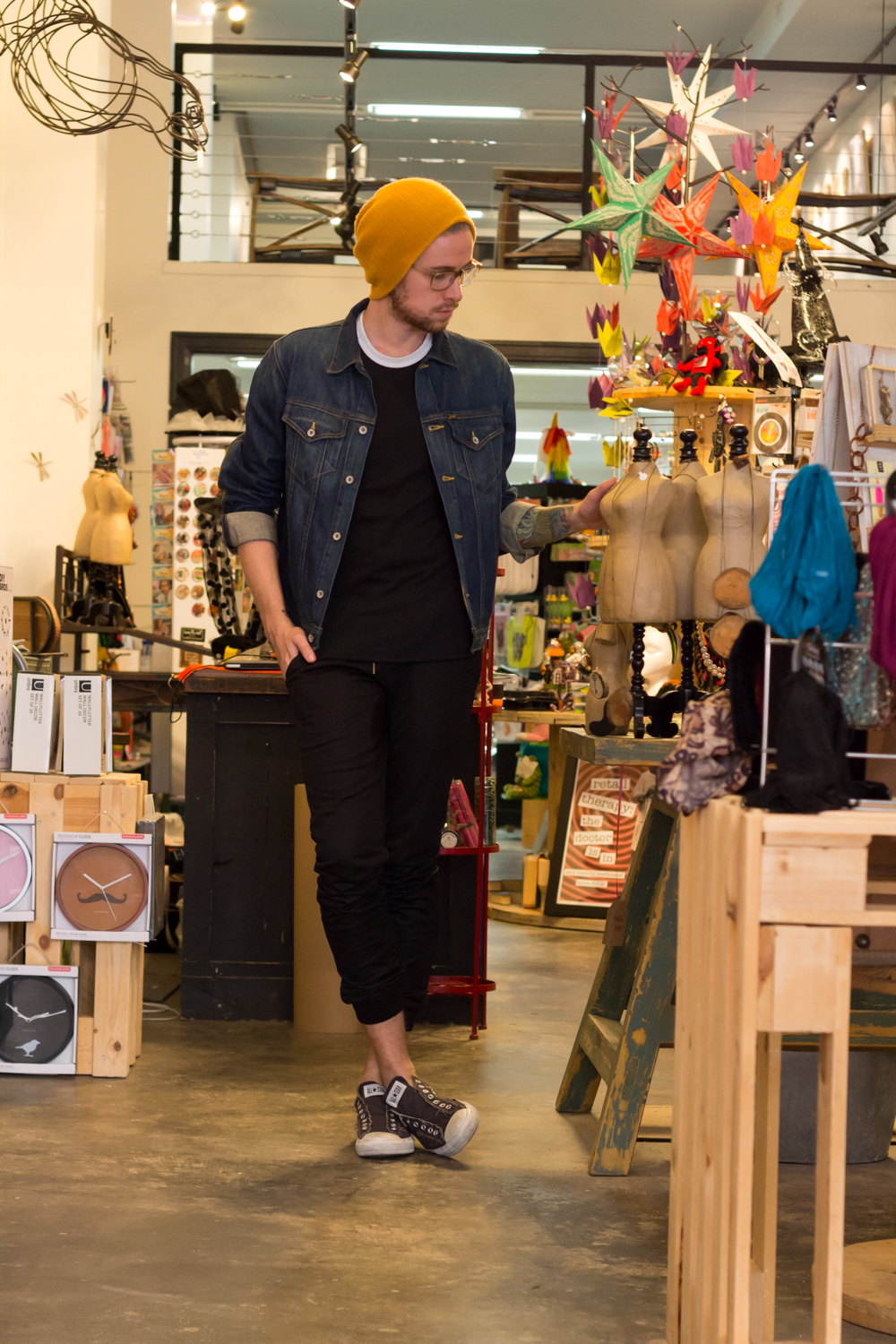 The Kentucky Gent, a Louisville, Kentucky blogger, in Forever 21 Beanie, Big Star Denim Jacket, American Apparel Baseball Tee, Zanerobe Mesh Joggers, and Converse Chuck Taylors at Regalo on South Fourth Street.