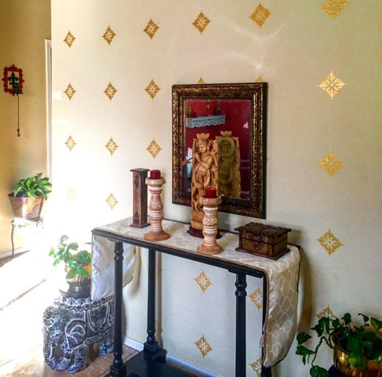 wall with gold stencils
